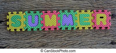 jigsaw written summer word on wood background