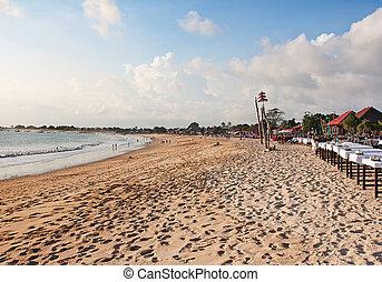 Jimbaran beach - Balinese Jimbaran beach at sunset. Jimbaran...