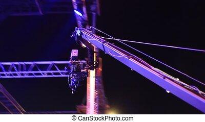 Jimmy Jib Crane Camera in action at night concert. Jimmy Jib...