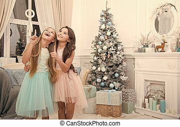 Jingle bells. Happy new year. Winter. Christmas tree and presents. xmas online shopping. Family holiday. The morning before Xmas. Little girls. Child enjoy the holiday