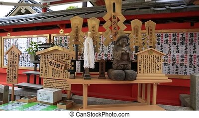 Wooden plaques or Ema, bearing people's prayerspeople at Jishu Jinja Shrine a temple dedicated to Okuninushi, a god of love. Jishu Shrine is prayed as the Cupid of Japan. Hilltop of Kyoto in Japan
