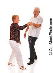 Jitterbugging Seniors - A jitterbugging senior couple....