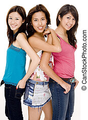 Three attractive young asian women in casual dress on white background