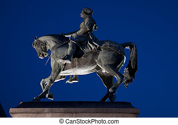 Joan of Arc Statue illuminated at night, Orleans, France