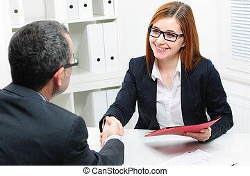 Job applicant having interview. Handshake while job...
