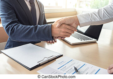 Job applicant having interview, Welcome to team Business people handshake with executive manager to Sign Approval Into the company, business meeting, Greeting deal, congratulation