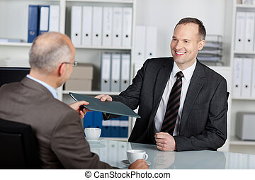 Job application - Portrait of a manager interviewing a male...