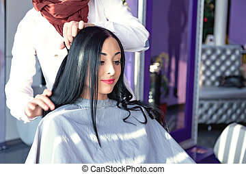 Job hairdresser and stylist. A girl with long black hair