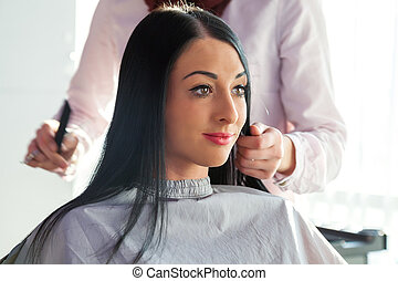Job hairdresser and stylist. Beautiful girl in a beauty salon.