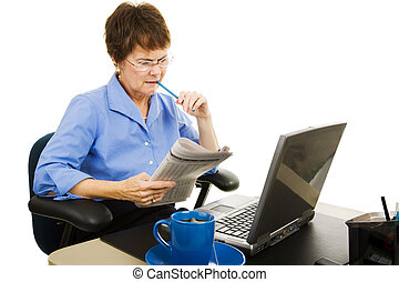 Job Hunt - Considering Options - Businesswoman going over...