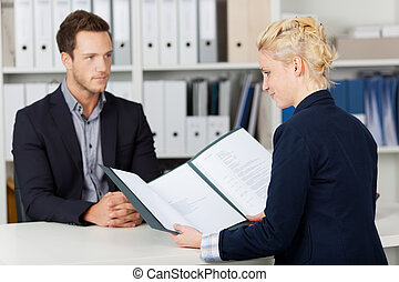 Recruiter and male candidate during a job interview