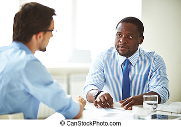Job interview - Serious manager talking to a candidate