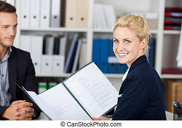 Job Interview - Smiling female recruiter and male candidate...