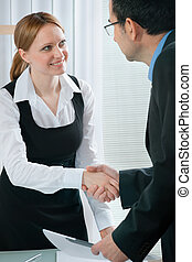 job interview - handshake during a  job interview