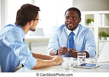 Job interview - Businessman talking to a new employee