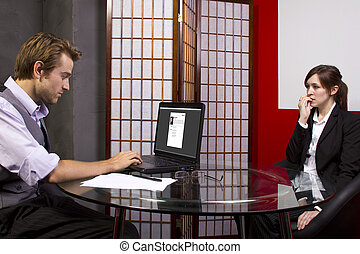 Job Performance Review - Manager reviewing workers job...