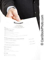 Job Search - Resume - Closeup of a businessman's hand...