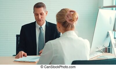 Job seeker in job interview meeting with manager and ...