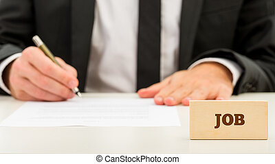 Job Text on Wooden Piece in Front Businessman