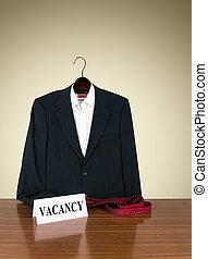 Job vacancy - desk with business suit on hanger, tie