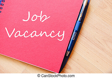Job vacancy write on notebook - Job vacancy text concept...