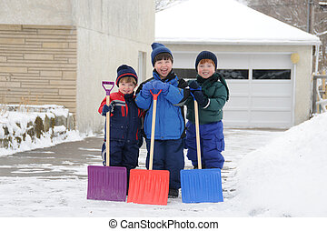 Job Well Done - Three young boys take pride in completing a...