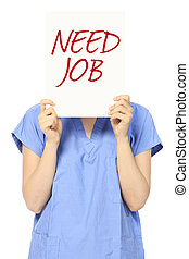 A woman in medical scrubs looking for a job