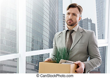 Jobless man standing in the office