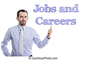 Jobs and Careers - Young businessman with small beard pointing up in blue shirt