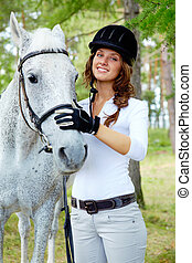 Jockey and horse - Image of happy female with purebred horse...