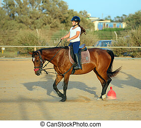 jockey - little girl riding a horse