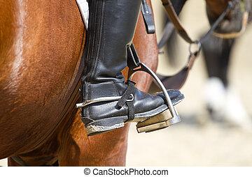 Jockey riding boot in the stirrup
