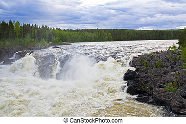 A beautiful and popular place above the arctic circle in Swedish Lapland, for (salmon) fishing and outdoor activities for tourists and others