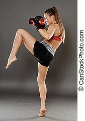 joelho, golpe, de, kickbox, mulher jovem