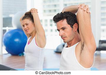 joga, sportliche , leute, dehnen, hände, klasse