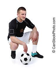 jogador de futebol, é, segurando bola, isolado, branco