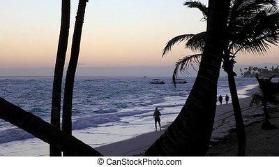 Jogger at sunrise - Jogger running at beach at sunrise