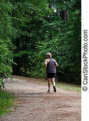 Jogger on Woodland Path