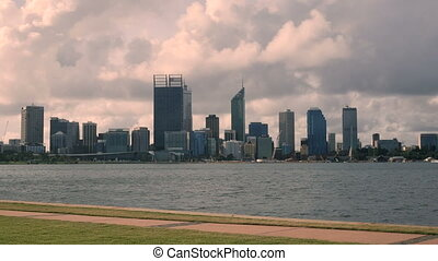 Jogger Perth Skyline - Jogger running in front of Perth...
