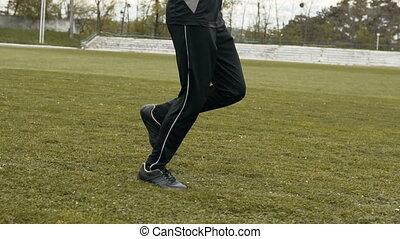 Jogger Runs on Green Stadium Grass