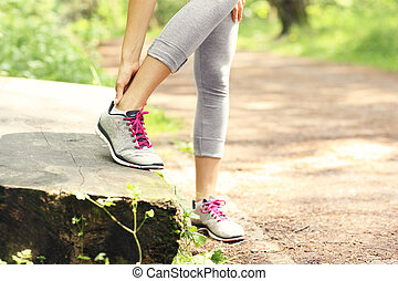 Jogger with hurt ankle - A picture of a jogger having...