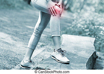 Jogger with hurt knee - A picture of a jogger having...