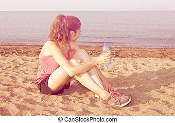 Jogger woman taking a break