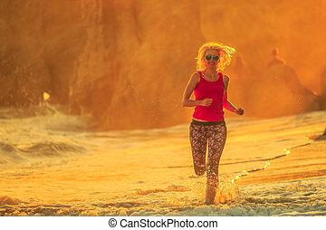Jogging at sunset beach