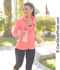 jogging, donna, parco, felice