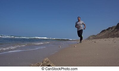 Jogging on the beach in slow motion