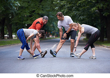 jogging people group stretching