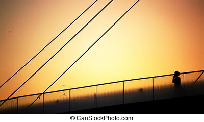 Jogging People on Bridge Sunset Backlit Silhouette