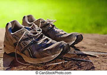 Jogging Shoes Beside Track Field
