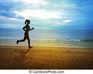 Jogging - Silhouette of a female figure jogging at the beach...